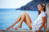 Beautiful female with slim legs posing over sea view - Fine Art prints