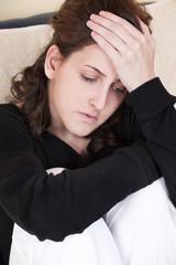 woman having headache at home