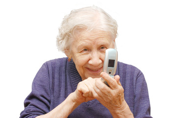 grandmother studies phone on an isolated background