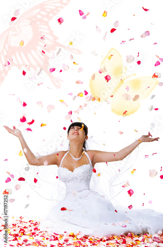 Cute bride throws rose petals and butterflys