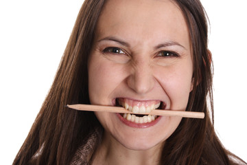 Young woman with pencil in her mouth