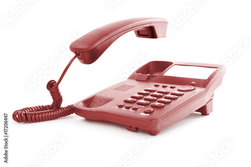 office phone with the handset in motion
