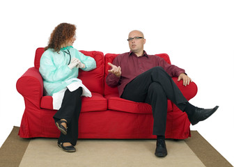 sitting on red sofa speaking with lady doctor man