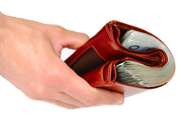 A brown wallet full of money isolated on a white background