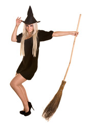 Halloween witch blond in black dress and hat with broom.