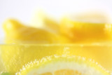 Fresh lemons in water with bubbles