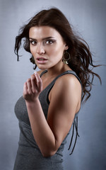 Surprisingly beautiful woman in a grey T-shirt with uncombed by
