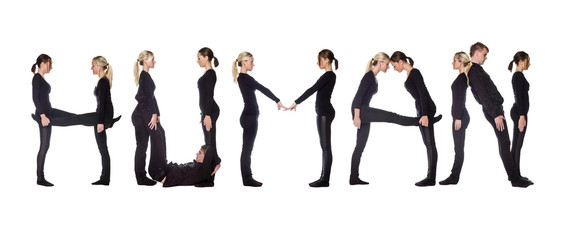 Group of people forming the word 'HUMAN'