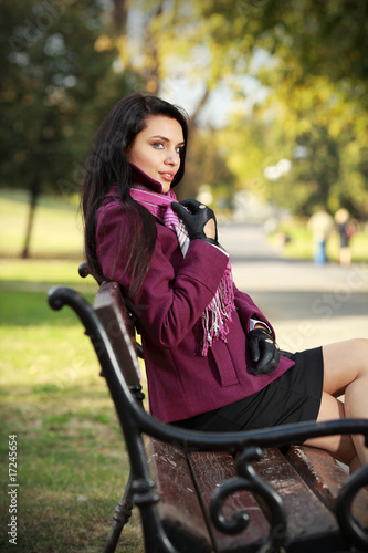 Beautiful romantic brunette in autumn park