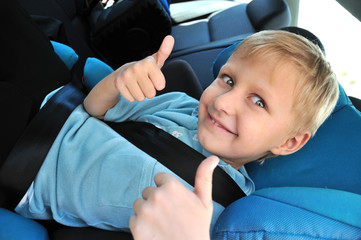 schoolboy using child safety seat