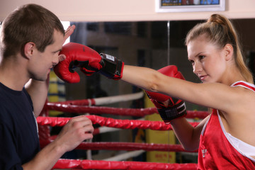 girl boxer with a trainer