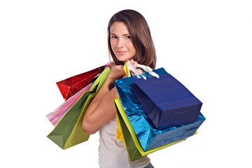 Young woman with shopping bags, positive
