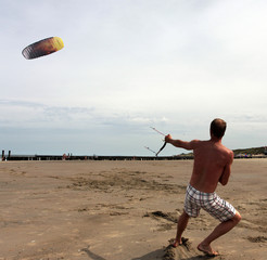 Kiting on a sandy beach