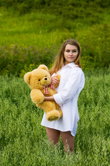 Young woman with teddy bear.