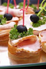 Ham sandwiches with olives and greens