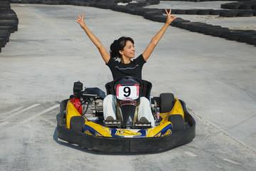 happy brunette women wining the karting race