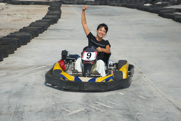 young female the winner of the karting race