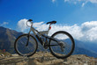 single mountain bike on a mountain rocky peak