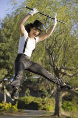 Jazz Dancer Jumping in Park