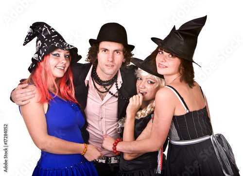 Group of people in  witch costume.