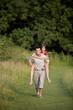 A man giving his girlfriend a piggyback