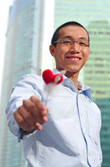 Asian Guy Holding A Heart Shape Stick