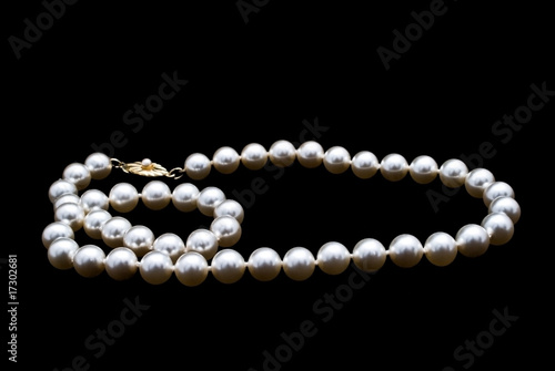 Pearls necklace on black background - 17302681