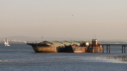 Barges moored in old industrial pier