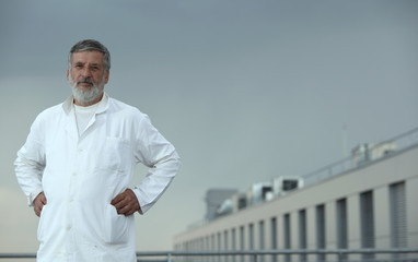 Renowned scientist/doctor standing on the roof of the research c