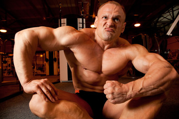 bodybuilder demonstrates his muscles