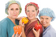 group of nurses with healthy fruits and vegetables