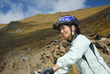 young happy woman riding safety a mountain bike