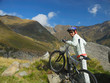 young woman on rocky mountain bike trial