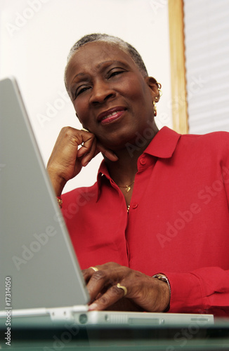 Older woman working on a laptop