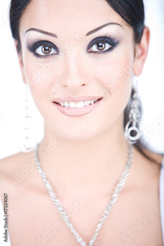 smiling gorgeous young woman with professional make up