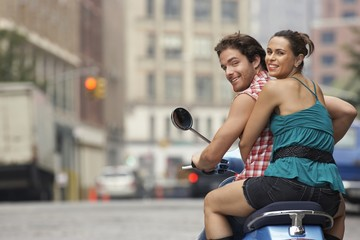 couple on motor scooter