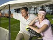 man and woman in golf cart