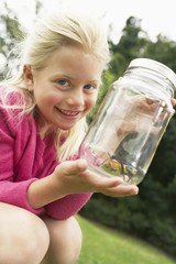 Girl Showing Insect in Jar