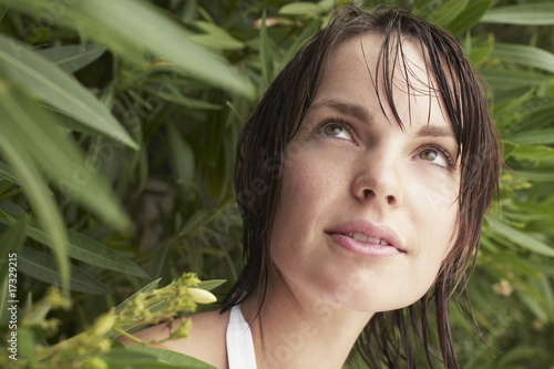Woman Looking Out From Shrub