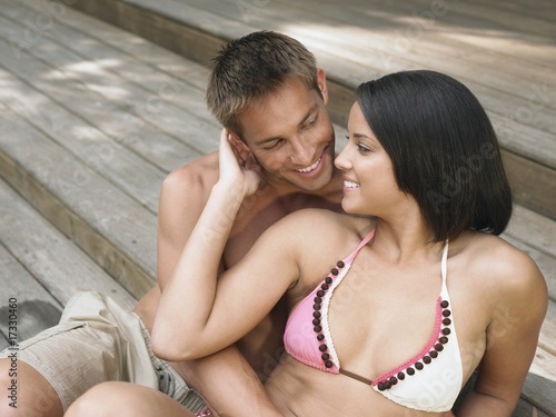 affectionate young couple relaxing on terrace