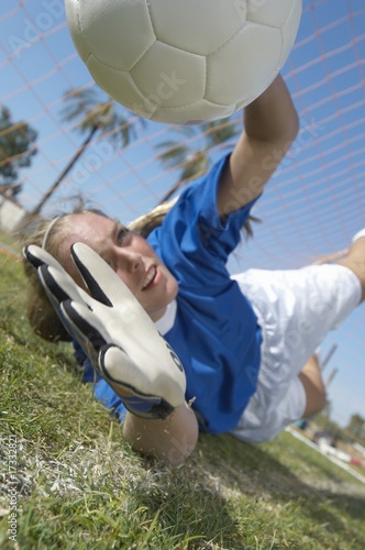 Girl Catching Soccer Ball
