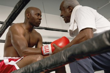 Boxer and Coach in Ring