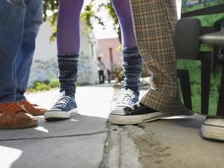 Teenage Friends on Sidewalk