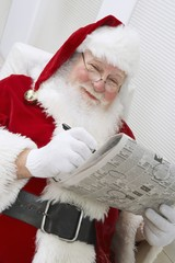 Santa Claus Reading Newspaper