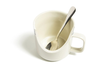Spoon in Broken Mug
