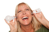 Funny Woman Holding Energy Saving and Regular Light Bulbs to Her poster