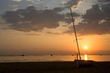 alba sul mare con barca poster