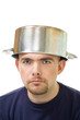 serious man with stew pan on head