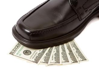 Close up of man shoe on money