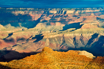 Cloud dappled grand canyon painted desert at sunrise